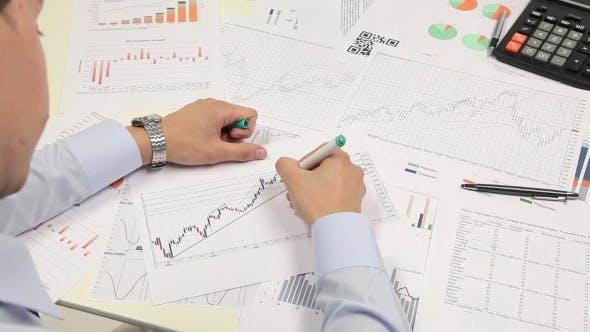 Thumbnail for Businessman Checking Diagram, Analyzing Market