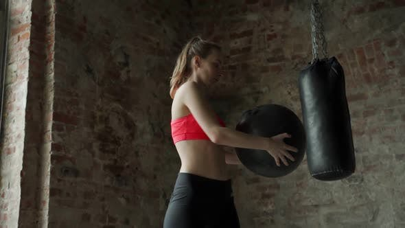 Fitness Woman Doing Exercises for the Press for Fitness with Fitness Ball in the Gym