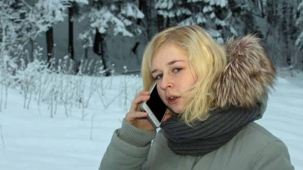 Cover Image for Girl Talking on the Phone in Winter