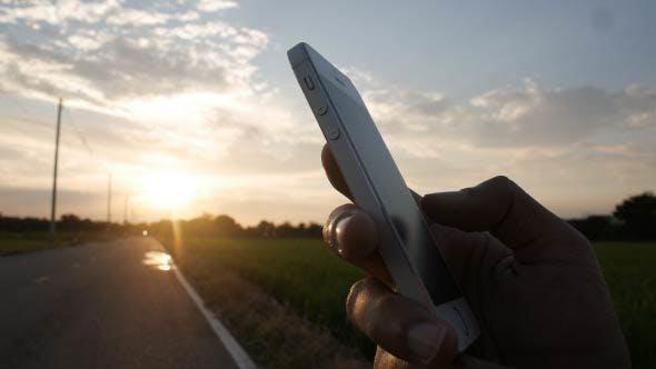 Thumbnail for Using Smartphone Sunrise