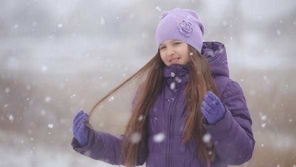 Thumbnail for Beautiful Smiling Child Is Happy Snowfall