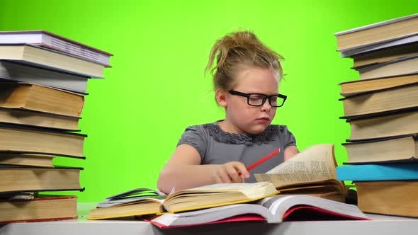 Thumbnail for Little Girl Sitting at the Table and Nervously Throws Book. Green Screen