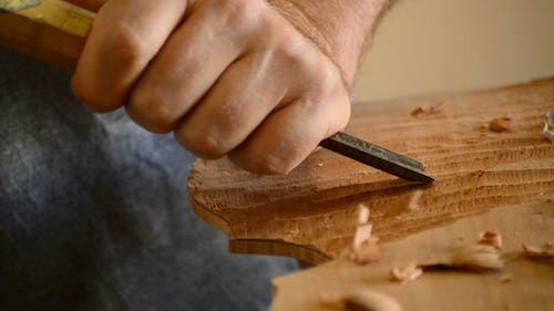 Luthier with a Chisel