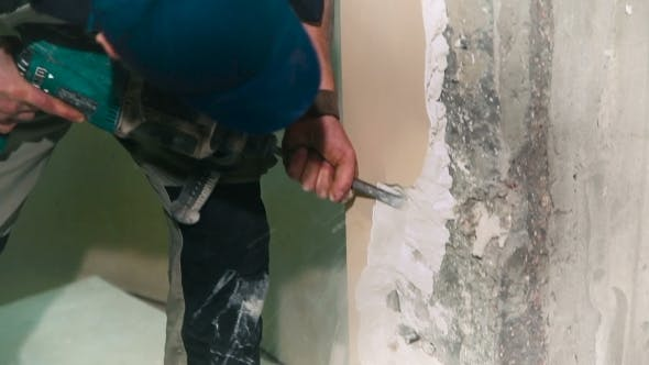 Thumbnail for Construction Worker Using a Hummer Drill