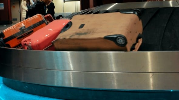 Thumbnail for Suitcases On Conveyor Belt Waiting For Owners