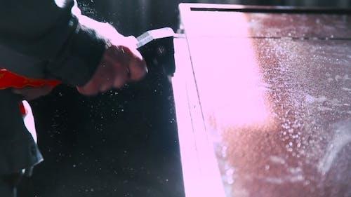 Worker Using Riveter In Doors Manufacturing