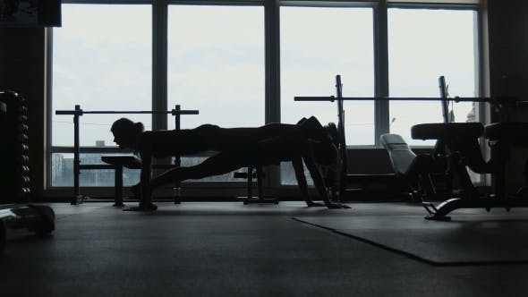 Thumbnail for Silhouette, Two Girls Do Push-ups Together