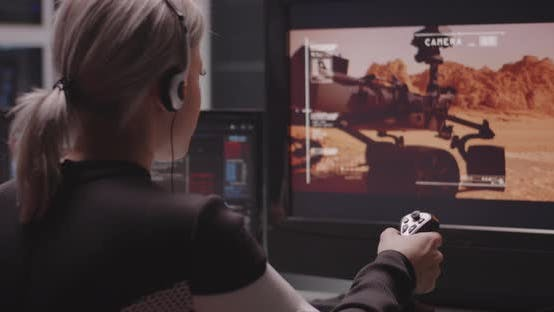 Woman Controlling Mars Rover with Remote Controller