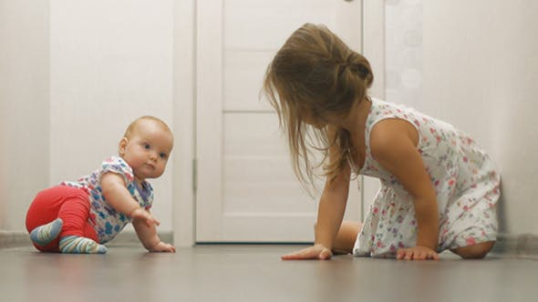Baby Girl And Little Girl Crawling