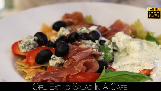 Cover Image for Girl Eating Salad In A Cafe 12