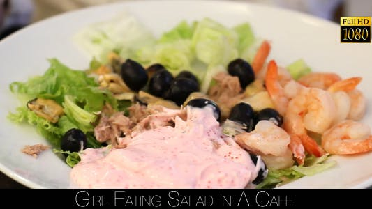 Thumbnail for Girl Eating Salad In A Cafe 13