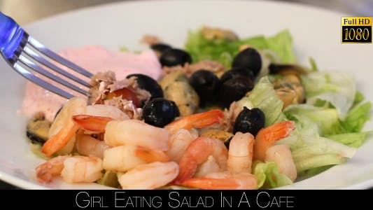 Cover Image for Girl Eating Salad In A Cafe 14