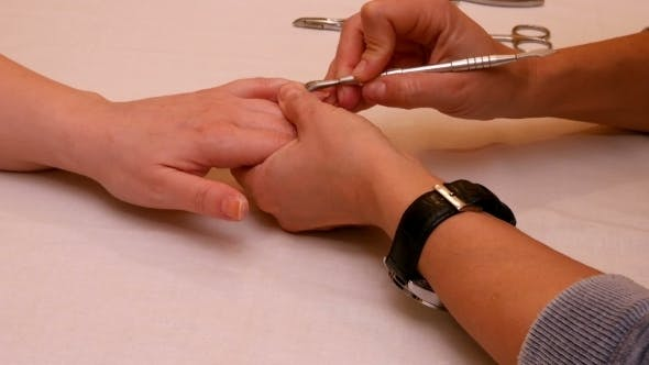 Thumbnail for Manicure Painting And Polishing Nails In Spa Salon