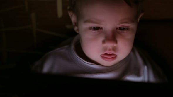 Thumbnail for Boy Browsing Tablet Pc In The Dark