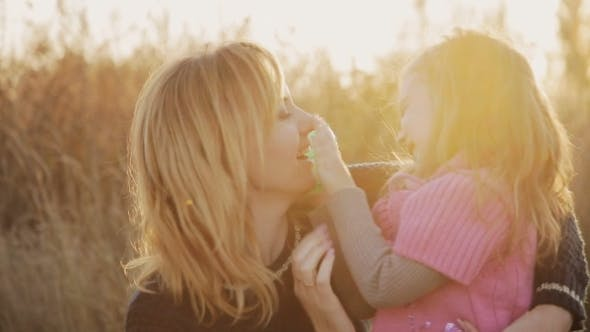 Thumbnail for Little Girl With Mother Kissing And Playing In The