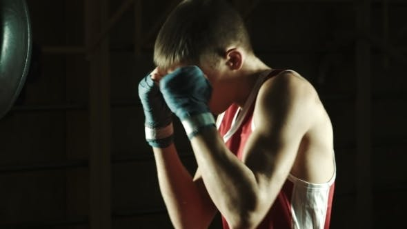 Cover Image for Young Caucasian Boxer Training With a Punching Bag