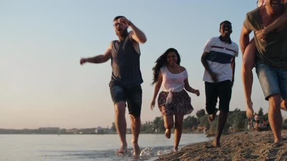 Thumbnail for Happy Friends Running on Beach
