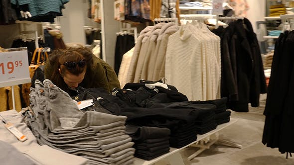 Thumbnail for Woman Choosing Clothes During Shopping