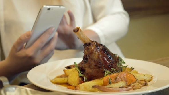 Thumbnail for Woman Taking Shot Of Delicious Restaurant Dish