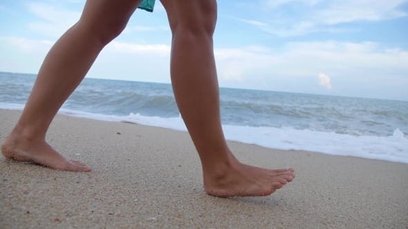 Thumbnail for Woman Legs And Feet Walking On Beach In Sea Foam