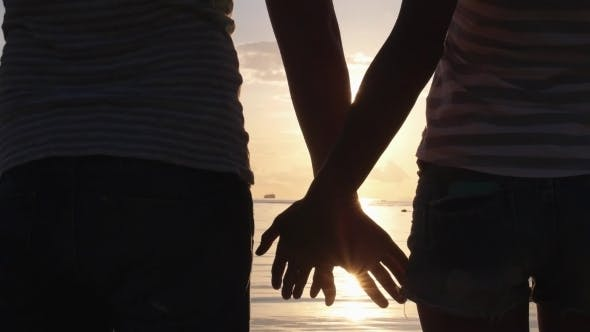 Thumbnail for Summer Couple Holding Hands At Sunset On Beach.