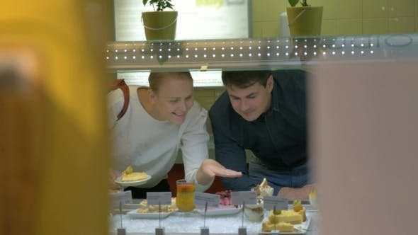 Thumbnail for Man And Woman Choosing Dessert In Cafeteria
