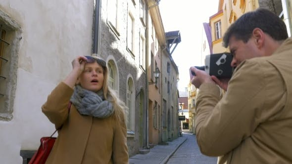 Thumbnail for Man With Retro Camera Shooting Flirty Blonde