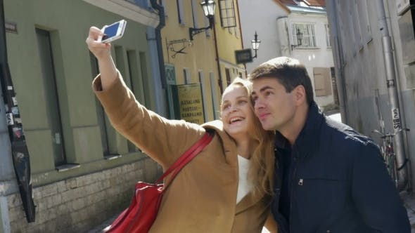 Thumbnail for Couple Taking Selfie With Smartphone In Tallinn