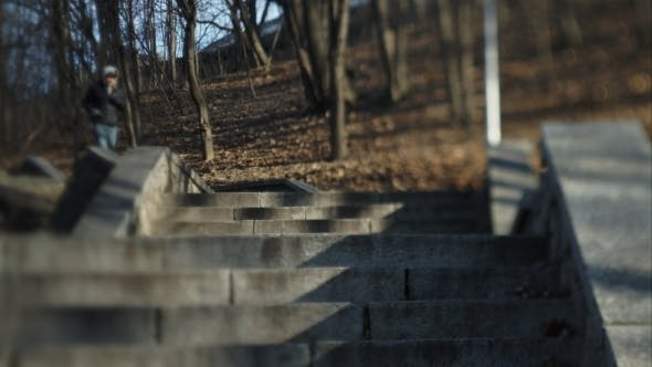 Thumbnail for A Man Running Up The Stairs To The Street