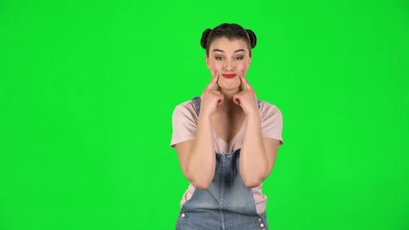 Thumbnail for Trendy Girl Poses for Camera Makes Funny Faces on Green Screen at Studio