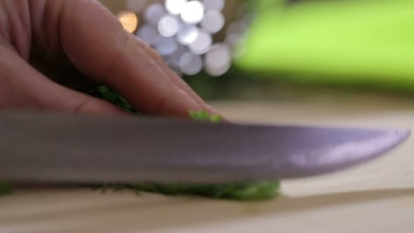 Thumbnail for A Woman Grinds Knife Green