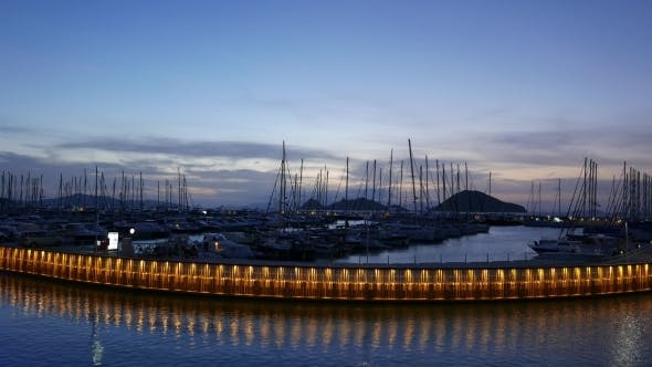 Yacht Marina By Night With Moored Sailing Boats