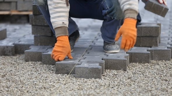 Cover Image for Worker Puts Sidewalk Tile