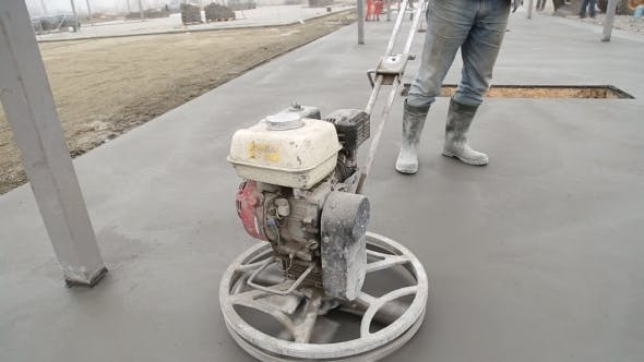 Thumbnail for Worker Smoothes Concrete Surface
