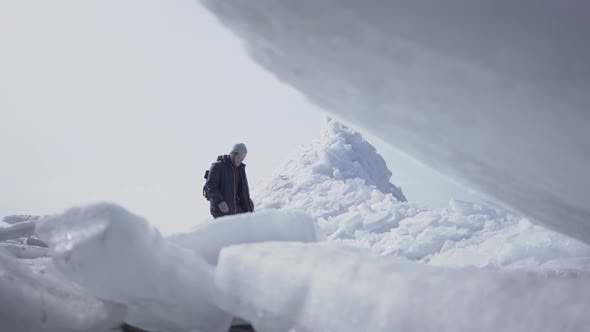 Thumbnail for The Lonely Male Tourist on the Background Walking on the Glacier