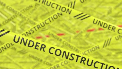 Yellow and Red Tapes with UNDER CONSTRUCTION Text
