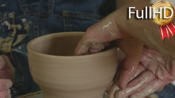 Thumbnail for Potter Craftsman is Teaching a Student Working