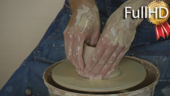 Potter Craftsman is Working on Pottery Wheel