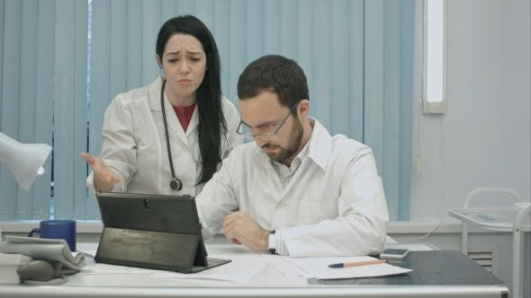 Thumbnail for Male And Female Doctors Discuss Results