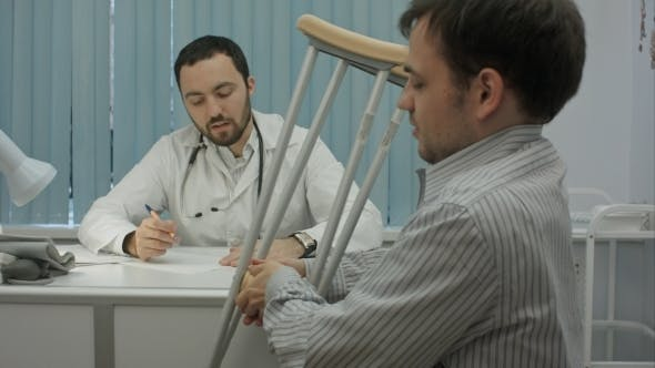 Thumbnail for Male Bearded Doctor In Clinic Consult Sick Client