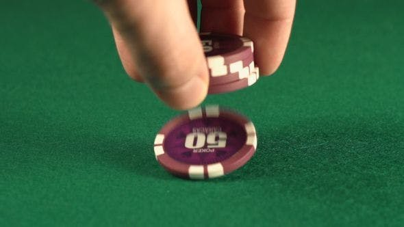 Thumbnail for Human Hand Takes And Falls A Playing Chips