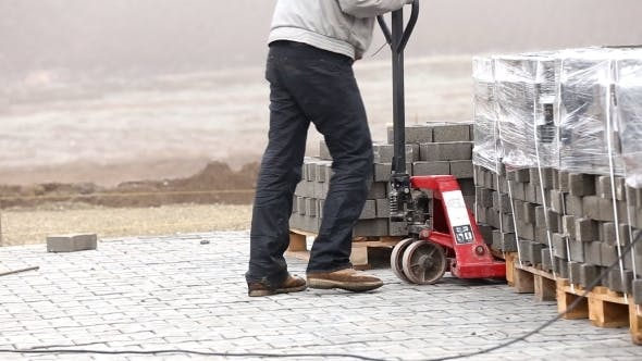 Thumbnail for Handcart Carrying Heavy Paving Slabs