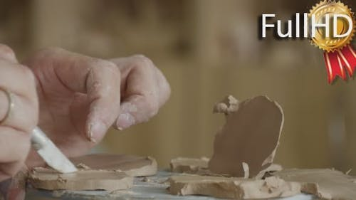 Craftsman is Making a Clay Souvenir