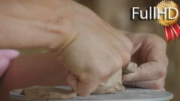 Thumbnail for Male of Female Potter Craftsman is Making a Clay