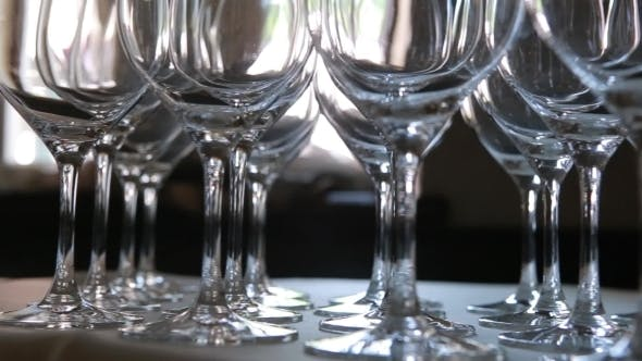 Thumbnail for Lot Of Glasses On The Table With White Tablecloth