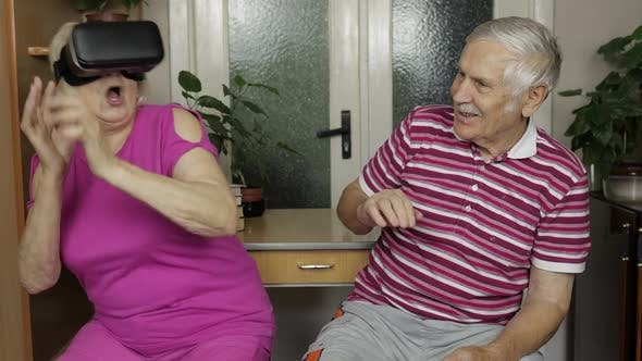 Thumbnail for Grandfather Scares Grandmother with VR Headset While She Watching Scary Virtual Reality Video Game