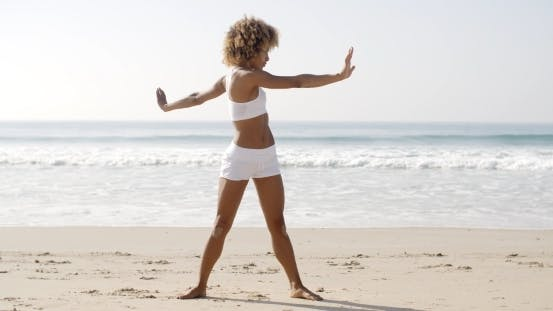 Thumbnail for Woman Practices Yoga On A Beach