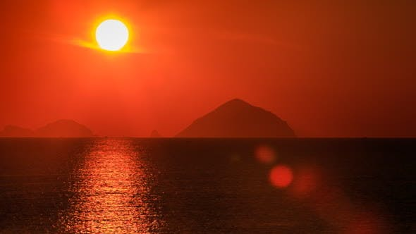Thumbnail for View of Big Sun Disk Sun-path Across Sea against Blurry Islands
