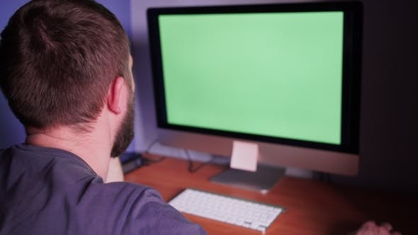 Thumbnail for Man At The Computer With Green Screen
