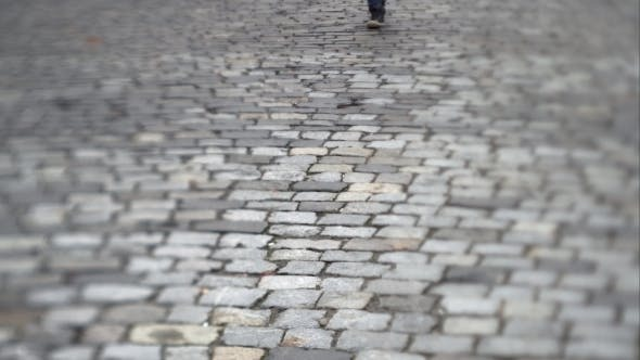 Thumbnail for Man Walking On a Stone Slab
